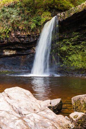 Beautiful waterfall in a forest (Sgwd Gwladys, Pontneddfechan, Wales)