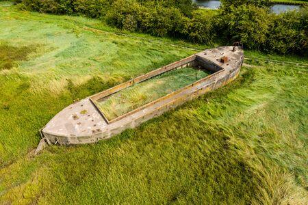 Aerial view of abandoned hulls of boats at the Purton Hulks (Ship Graveyard)