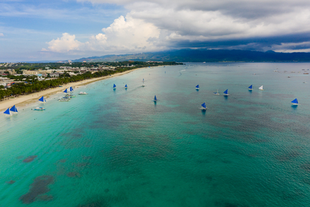 BORACAY, PHILIPPINES - 17 JUNE 2019: Sailing boats on Boracay Islands White Beach in the Philippines