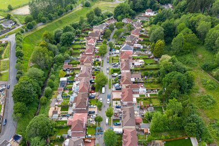 Aerial drone view of a residential area of a small Welsh town surrounded by hills (Ebbw Vale, South Wales, UK) Stockfoto