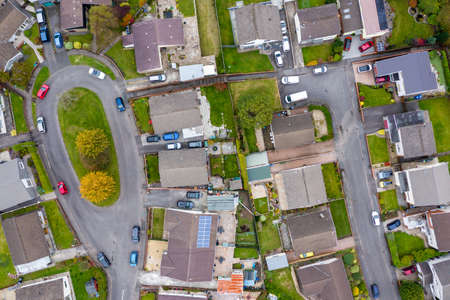 Aerial view of residential streets and cul de sacs in the autumn (Wales, UK)