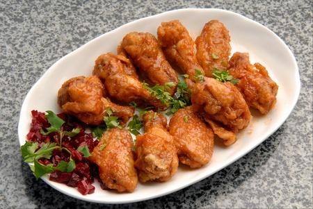 and chicken wings: chicken wings in sauce with fresh vegetables Stock Photo