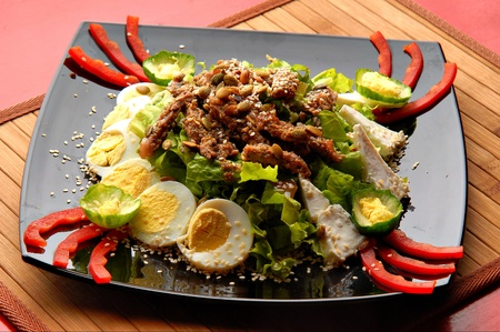 salad with fresh cabbage, eggs and nuts on a plate Stock Photo