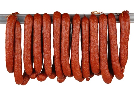 boiled sausage: tasty sausage meat on a white background