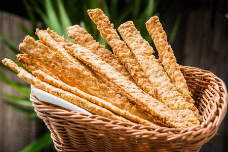 breadstick: Crispy bread sticks on old wooden table. Stock Photo