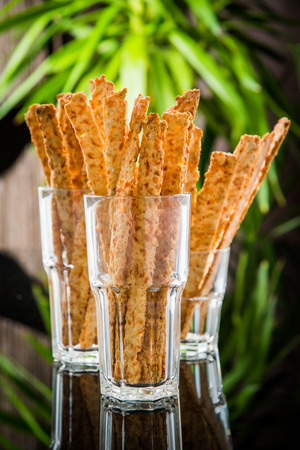 Crispy bread sticks on old wooden table. Stock Photo