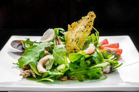 salad with seafood and toast on a plate Stock Photo