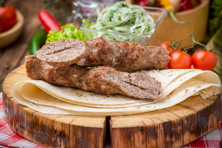 ramzan: grilled beef meat on the grill kebab on pita bread and a wooden plate