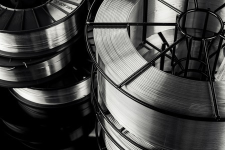 welding wire, stainless steel, on a black background 写真素材