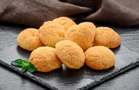 Amaretti cookies in a glass bowl on old wooden background.Italian amarettini biscuits. Stock Photo