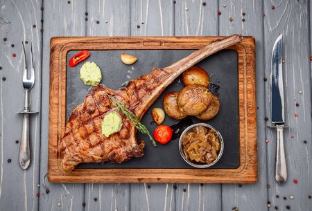 Succulent grilled tomahawk beef steak on the bone