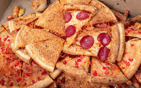 pizza food dumped in trash Stock Photo