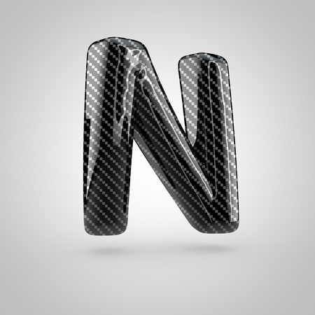 surface: Black carbon letter N uppercase. 3D rendering font with glint and light reflections isolated on white background. Stock Photo