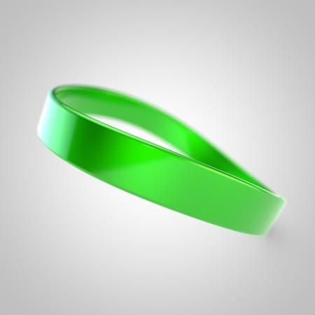Blank promo bracelet. Green silicone bracelet for hand isolated on white background