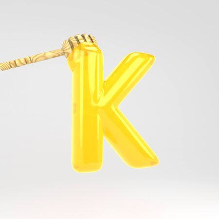 Letter K uppercase. Honey font with dipper. 3d rendered yellow alphabet type isolated on white background. Stok Fotoğraf