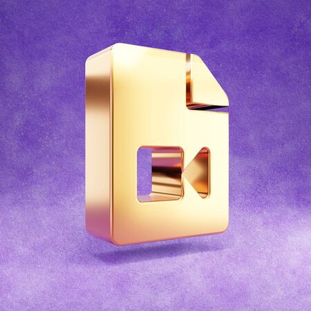 Video file icon. Gold glossy Video file symbol isolated on violet velvet background.