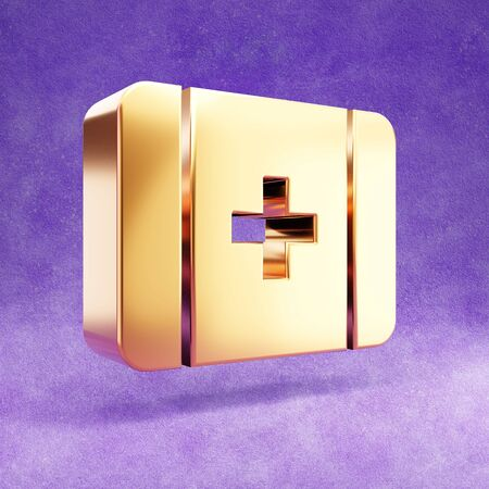Medkit icon. Gold glossy Medkit symbol isolated on violet velvet background.