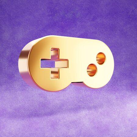 Gamepad icon. Gold glossy joystick symbol isolated on violet velvet background.