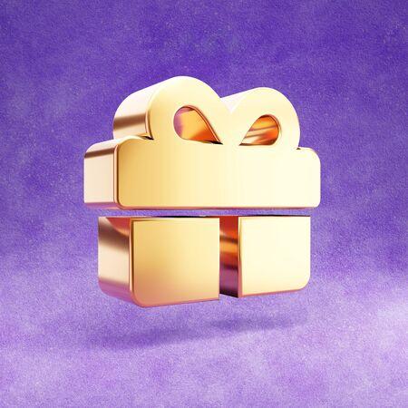 Birthday present icon. Gold glossy gift symbol isolated on violet velvet background.