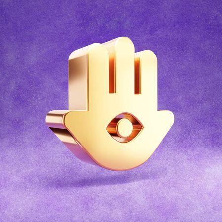 Hamsa icon. Gold glossy Hamsa symbol isolated on violet velvet background.
