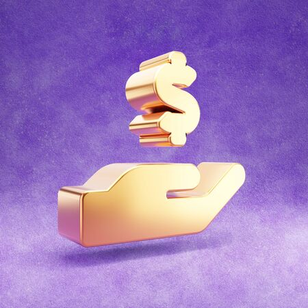 Hand holding dollar icon. Gold glossy hand with dollar symbol isolated on violet velvet background.