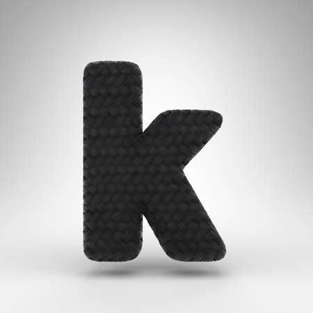 Letter K lowercase on white background. Black carbon fiber 3D rendered font with carbon thread texture.