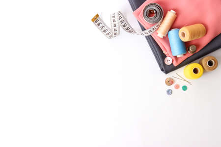 Set of different sewing accessories on a white background close-up