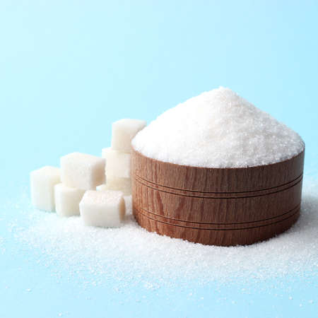 Refined sugar on a colored background. Diabetes concept, excess sugar