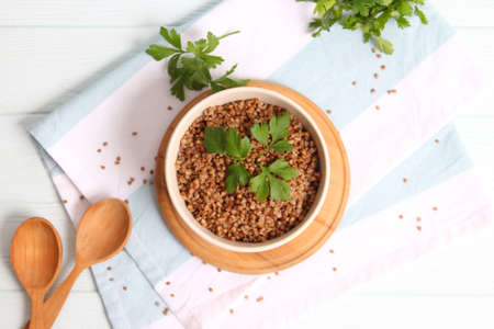 boiled buckwheat in a plate on the table.