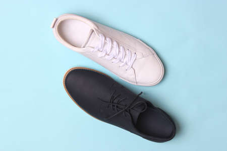 mens office shoes and sneakers on a colored background top view. mens shoes,