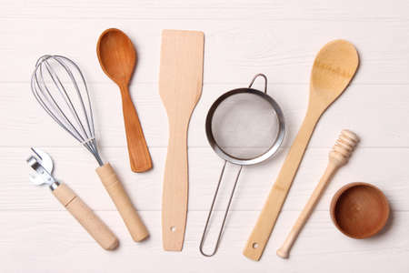 different kitchenware on a light background top view. Cooking appliances.