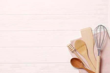 different kitchenware on a light background top view. Cooking appliances. Standard-Bild
