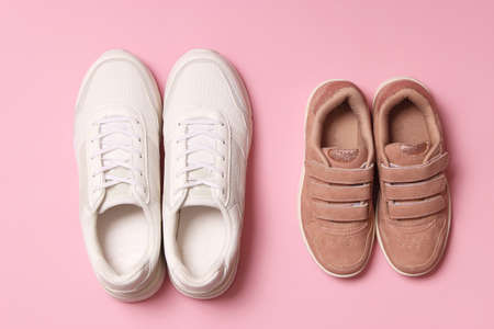 shoes for children and womens sneakers on a colored background top view.