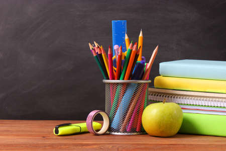 School stationery on the background of the school board. Imagens