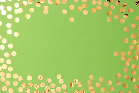 sparkles confetti and frame for inserting text on a colored background top view. Stockfoto - 168130227