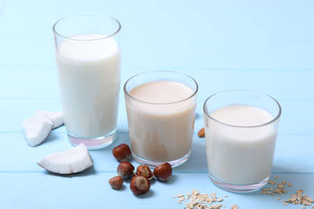 Different types of vegetable milk on the table.