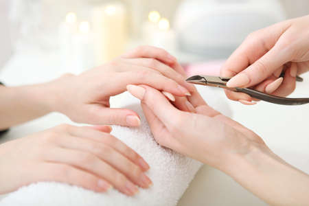 Closeup shot of a woman in a nail salon getting a manicure