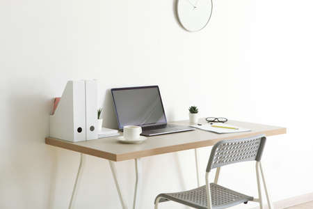 Workplace with modern laptop in the interior of the room Imagens