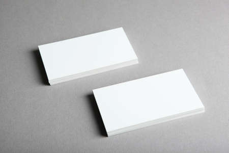 business cards on a colored background top view. Place to insert text