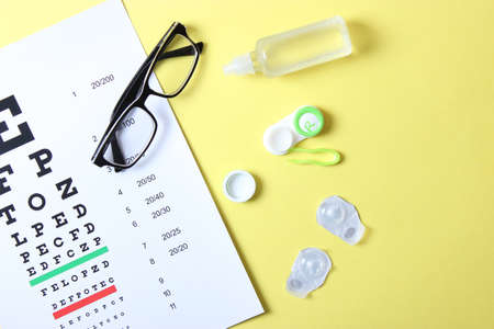 table for checking vision, glasses and lenses for correcting vision Фото со стока