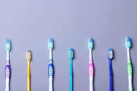 Toothbrushes on a colored background top view. Oral hygiene.