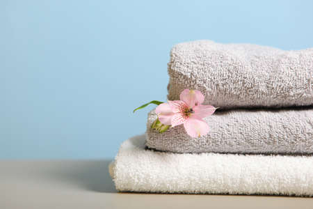 a stack of fresh towels on the table.