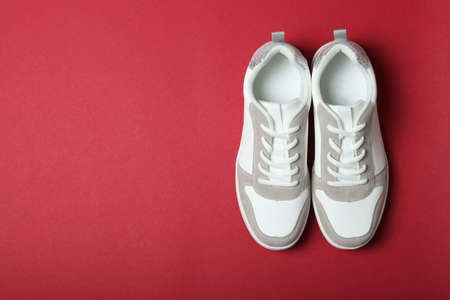 womens sneakers on a colored background. Womens shoes.