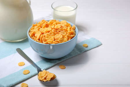 Delicious cornflakes in a plate on the table.