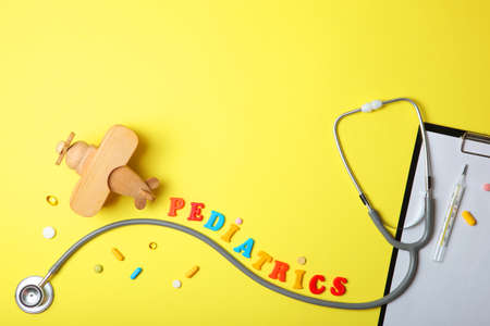 Pediatrics concept. Stethoscope and toy on a light background