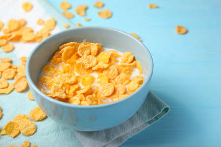 Crispy cornflakes with milk for breakfast on the table close-up.