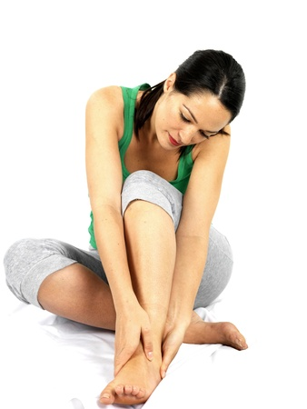 Young Woman with Ankle Injury. Model Released Stock Photo - 15501635