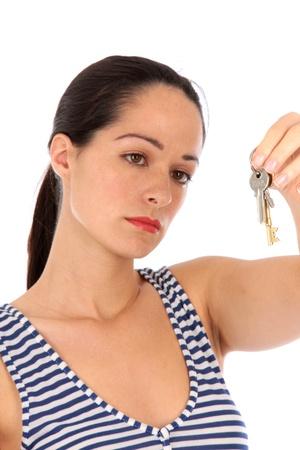 Sad Young Woman Handing Over Keys