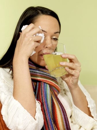 30 something women: Sick Woman Drinking Soluble Medicine Stock Photo