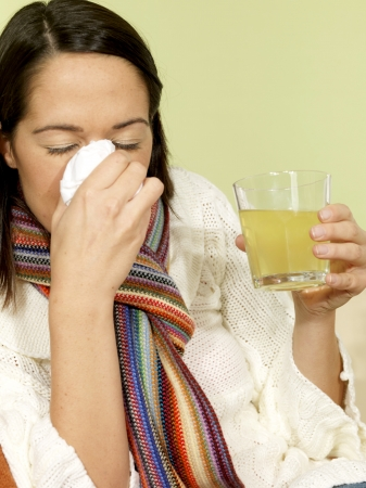 Young Woman with a Cold Blowing Nose Stock Photo - 15502068
